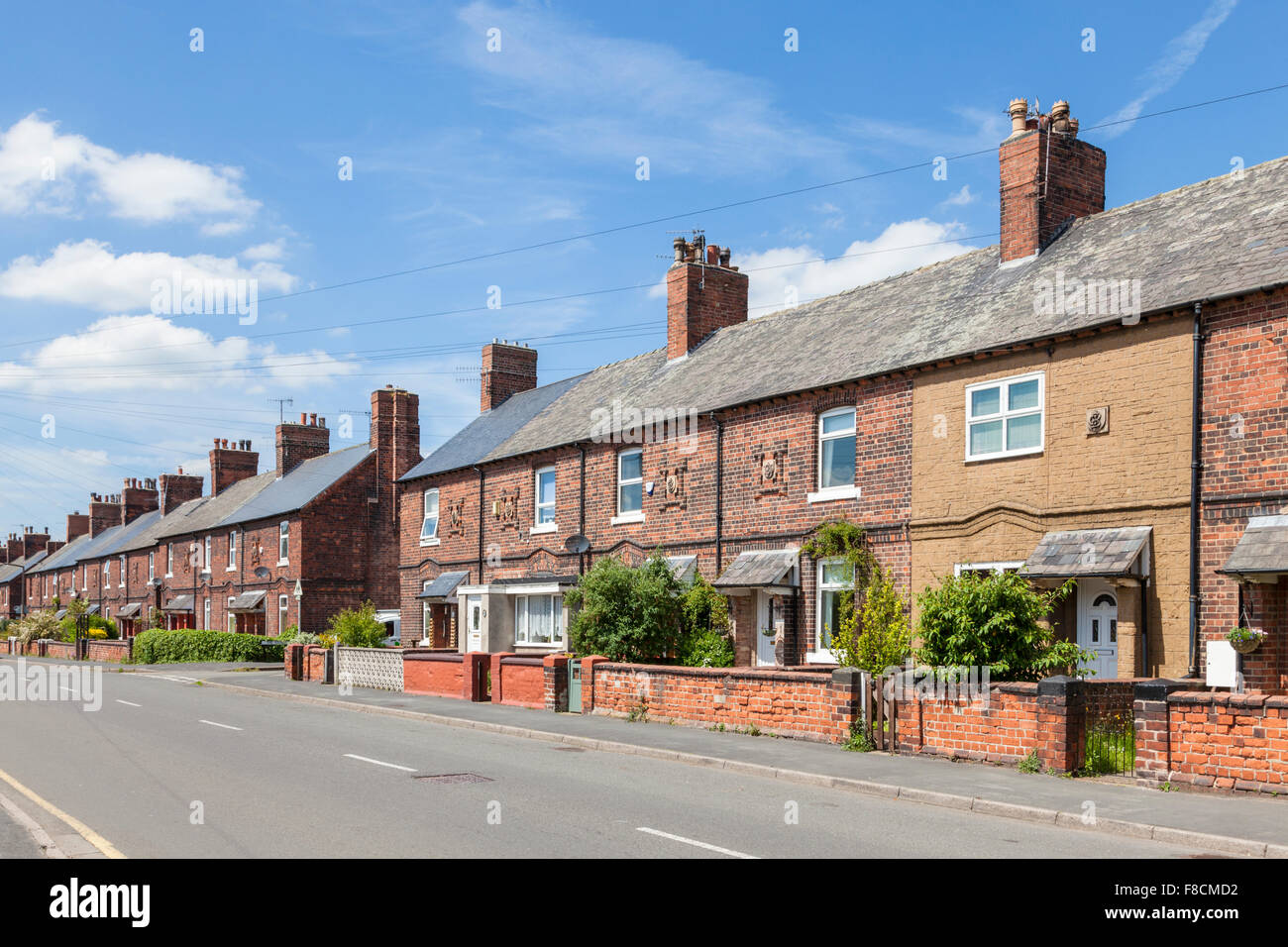 Row of terraced housing for colliery workers on a street at Bestwood Village, Nottinghamshire, England, UK - Stock Image