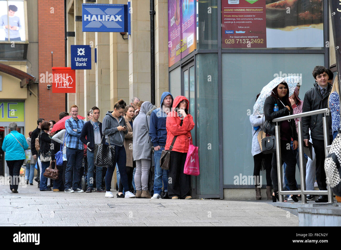 Unemployed queued outside job fair in Londonderry, Northern Ireland - Stock Image