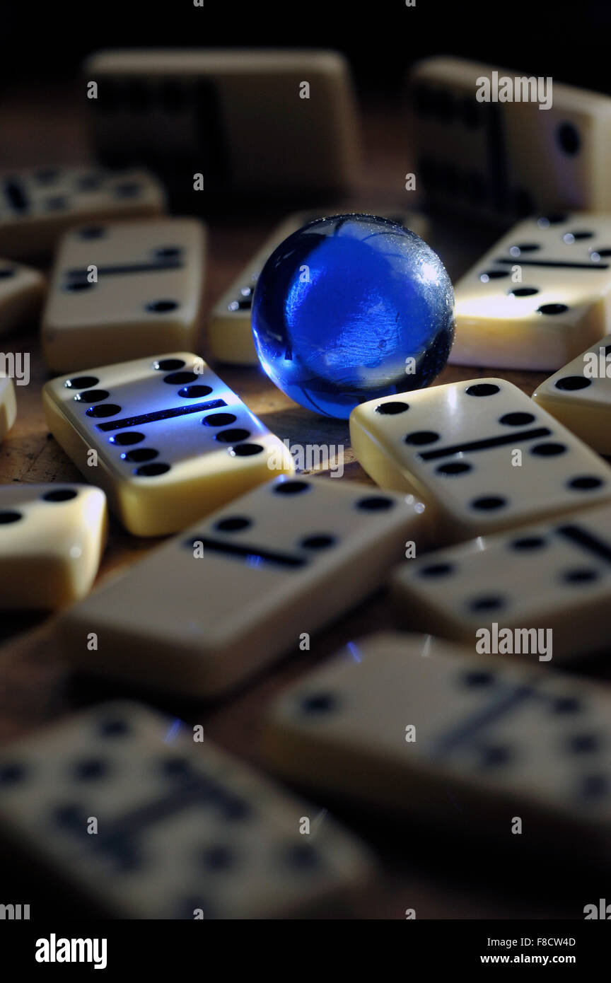 blue glass marble with dominoes - Stock Image