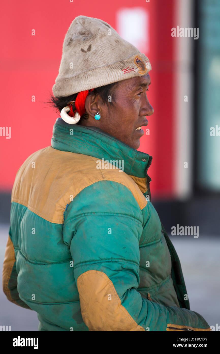 Tibetan guide in Lhassa - Stock Image