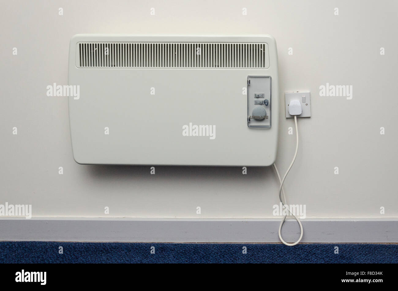 Electric room heater on a wall - Stock Image