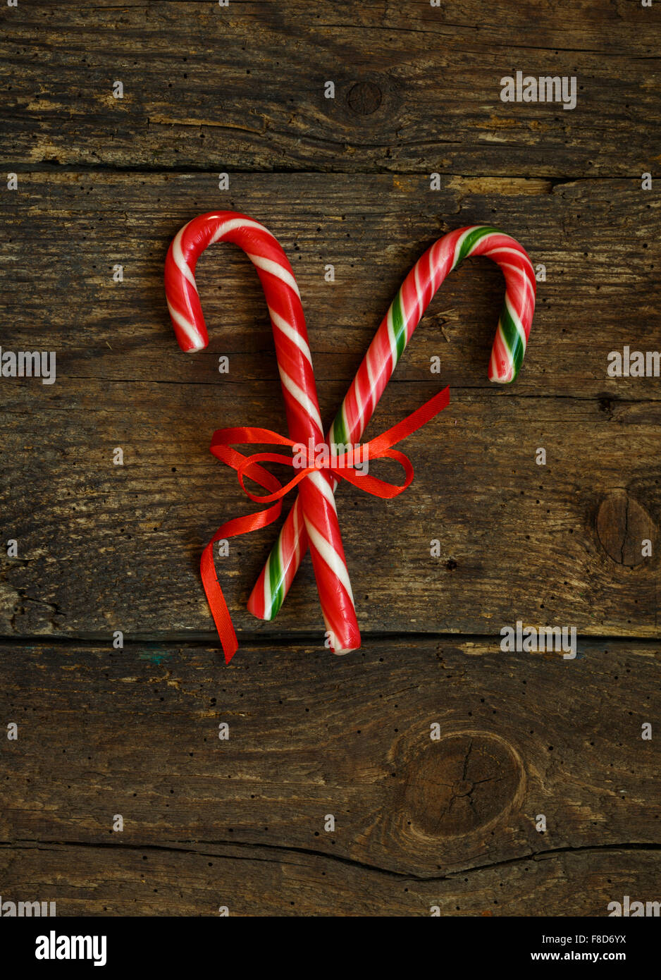 Closeup of two old fashioned candy canes on a rustic wooden Stock ...