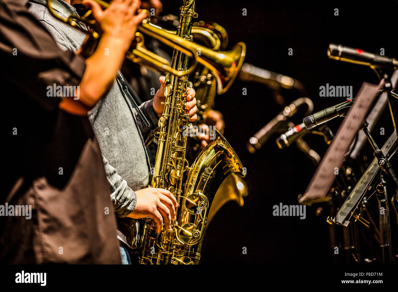 Jazz music : a musician playing a saxophone in a group - Stock Image