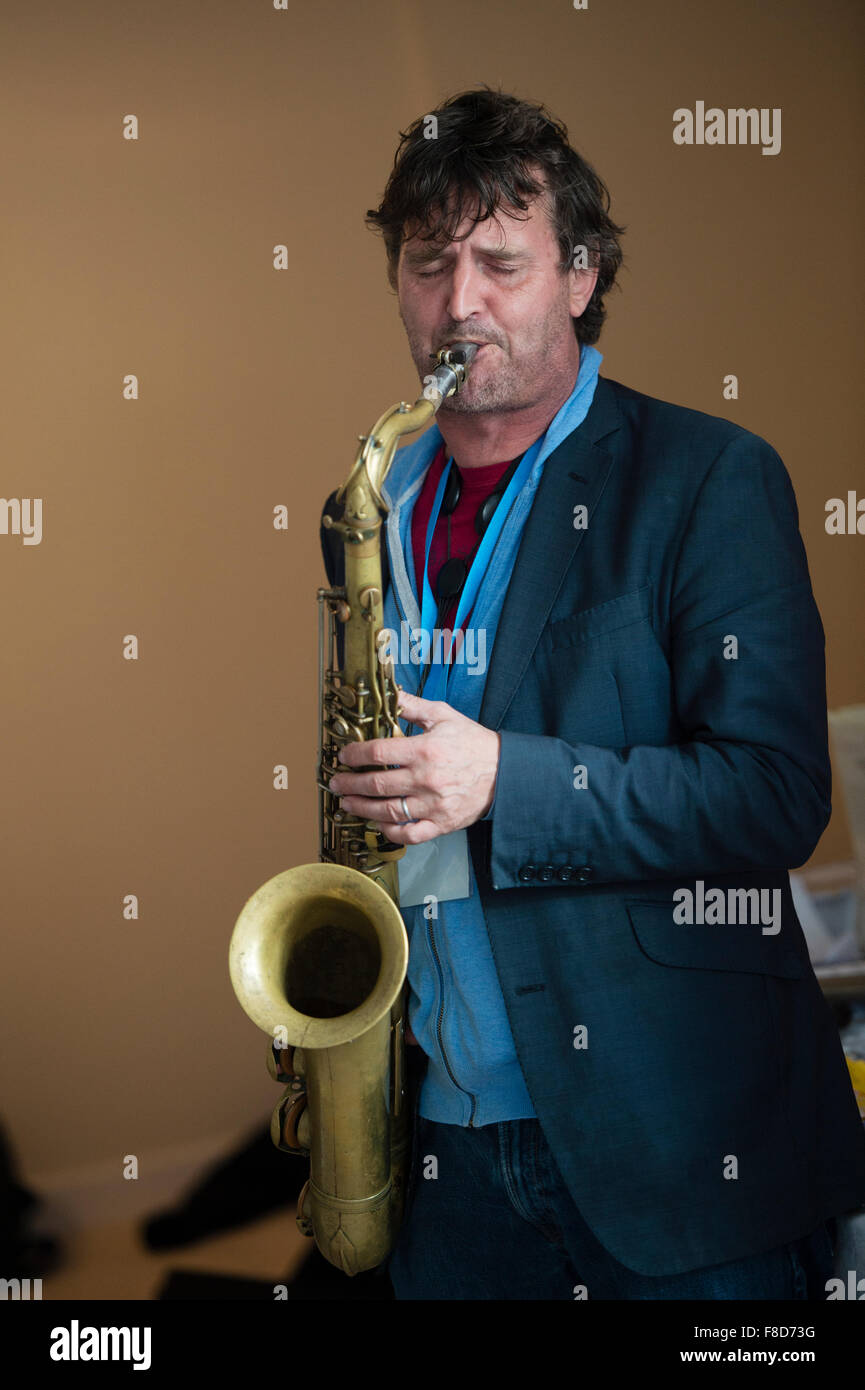 Jazz music : a musican playing a solo on his saxophone in a group - Stock Image