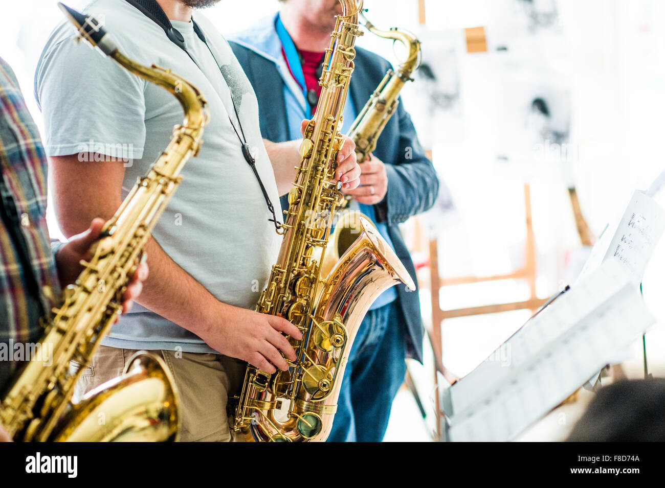 Jazz music : three musican playing  saxophones in a group - Stock Image