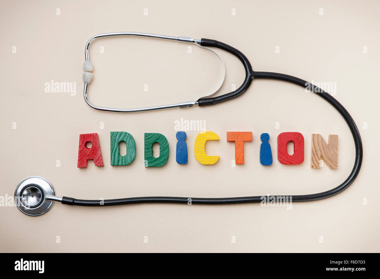 High angle of word ADDITION and a stethoscope - Stock Image