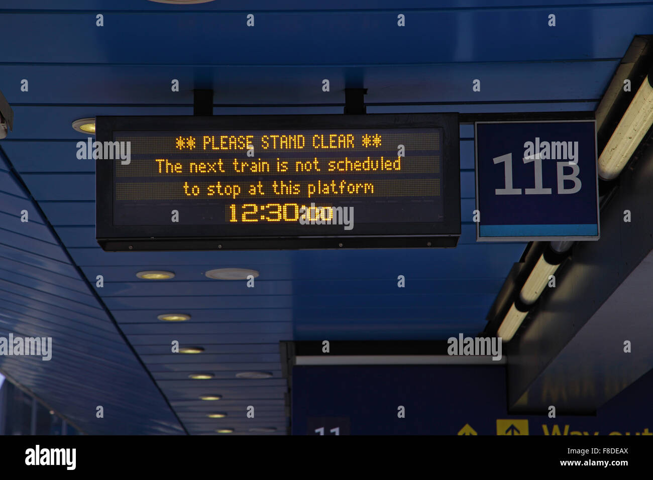 The passenger Information System screen showing a train passing through the platform on 11B at 12-30 . - Stock Image
