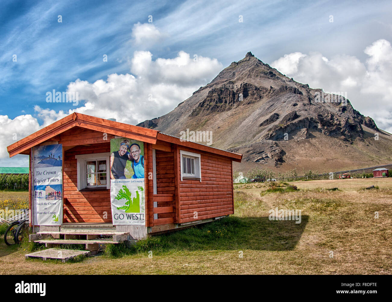 Snaefellsnes Peninsula, Iceland. 30th July, 2015. A wooden cabin with posters advertising tours of Iceland beneath Stock Photo