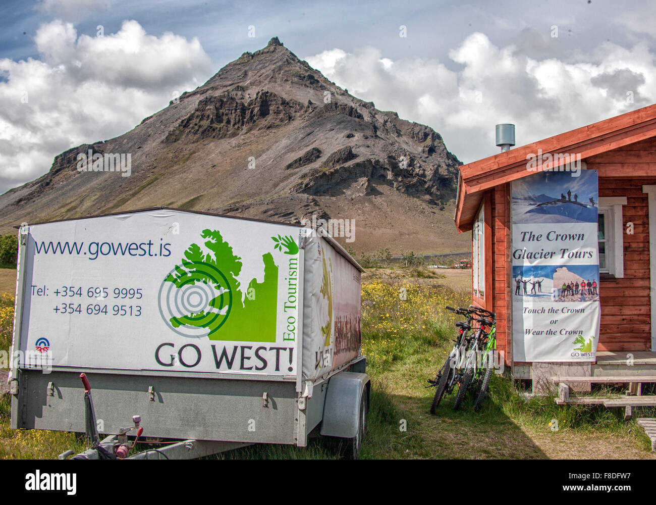 Snaefellsnes Peninsula, Iceland. 30th July, 2015. A wooden cabin and a trailer with posters advertising tours of Stock Photo