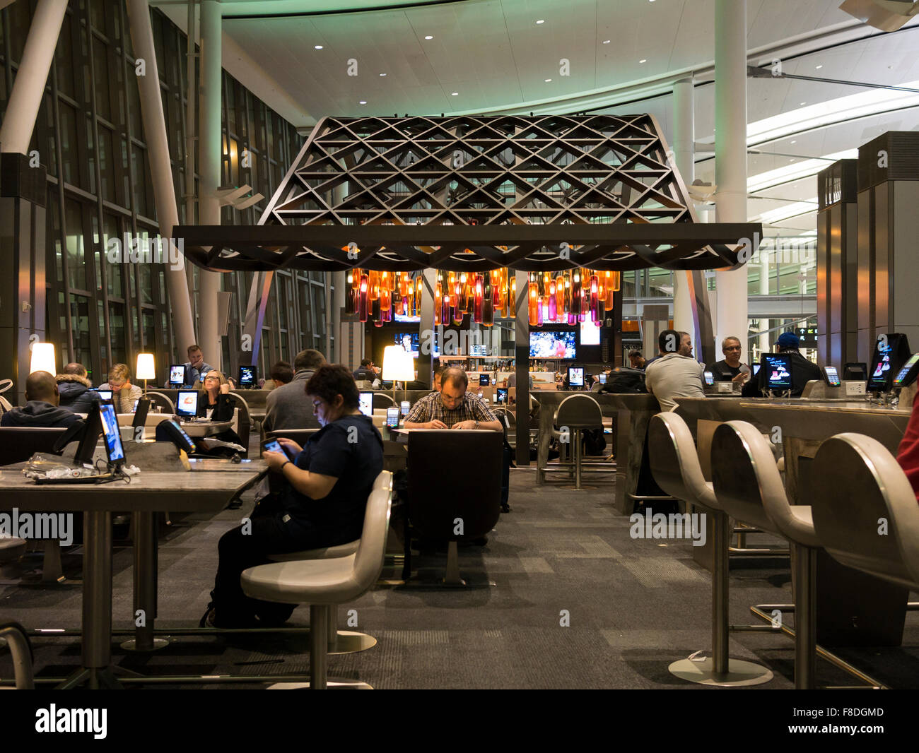 Toronto international airport Terminal 1 departure lounge food court; modern and dining tables connected with tablets - Stock Image