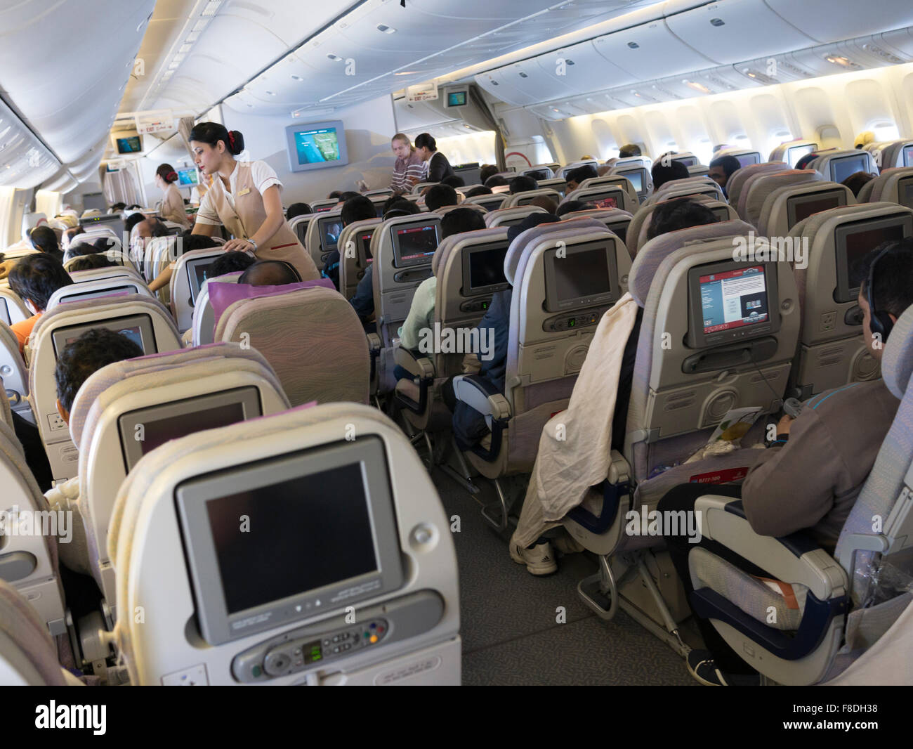 Inside An Emirates Flight From Bangalore To Dubai Passengers Watching In Entertainment