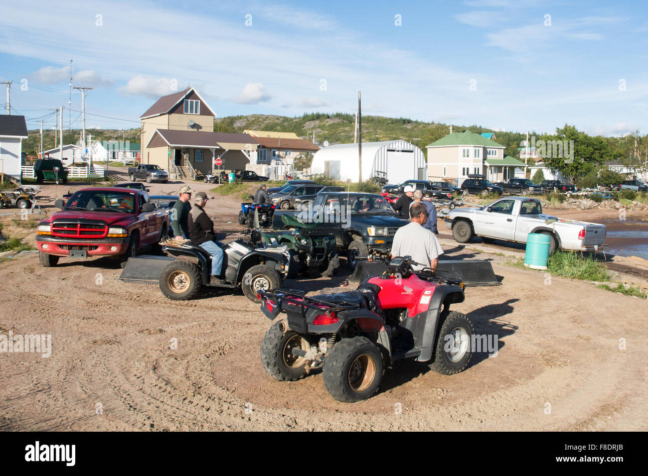 Men on quads in the village of St. Augustine, located on the Gulf of St. Lawrence, Lower North Shore region, Quebec, - Stock Image