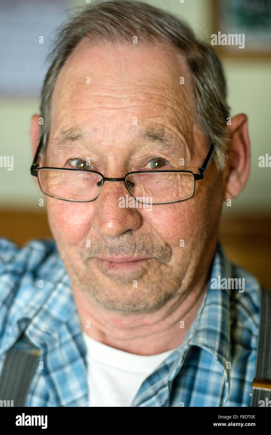 Portrait of an elderly retired Canadian fisherman from a rural village in Newfoundland and Labrador, Canada. - Stock Image
