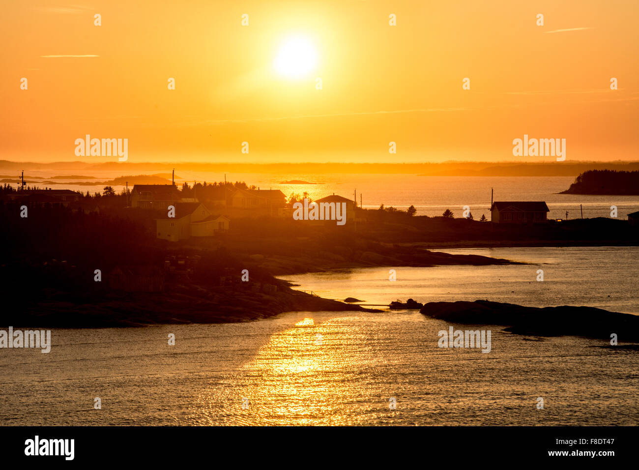 Sunset over the Innu First Nation fishing village of La Romaine on the Gulf of St. Lawrence, Lower North Shore, - Stock Image