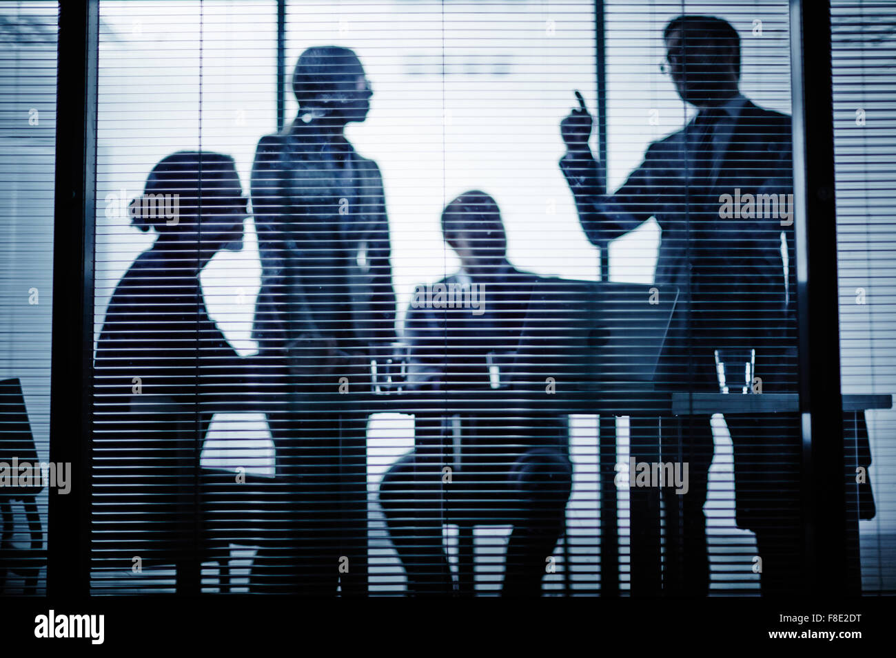 Group of co-workers talking at meeting in office - Stock Image
