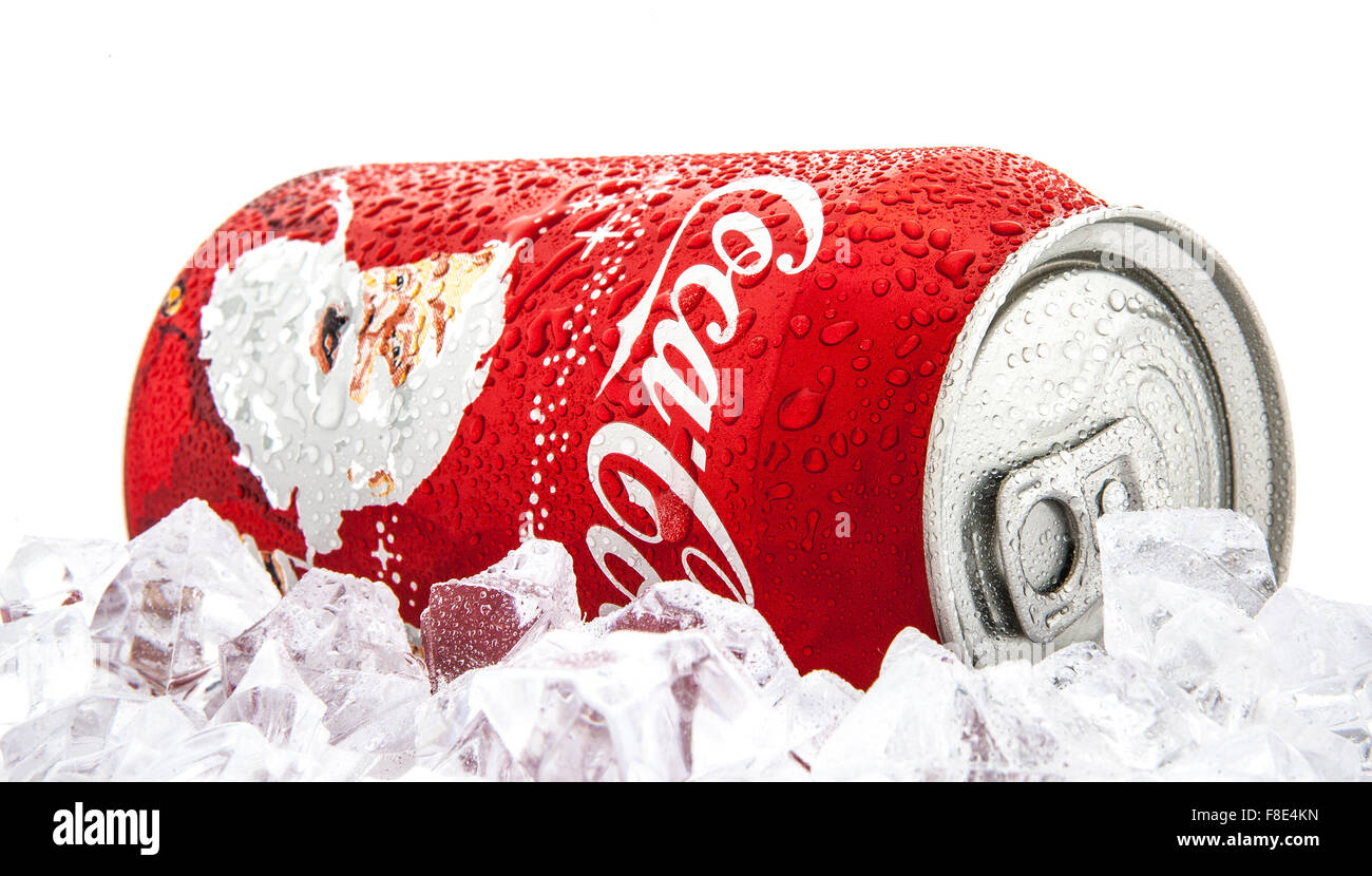 Christmas Can Of Coke on a bed of ice over white background - Stock Image