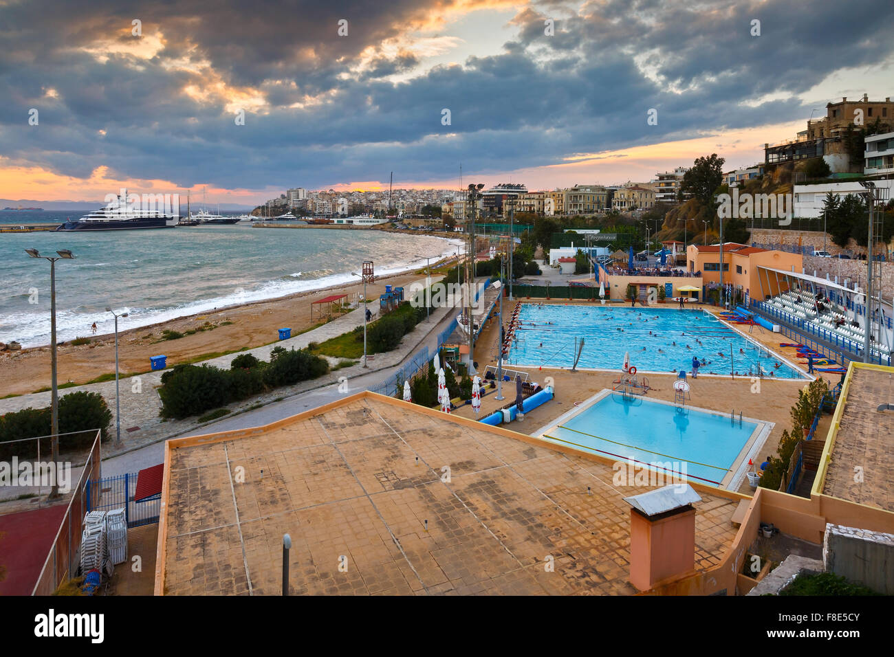 View of the municipal swimming pool in Piraeus and mouth of Zea marina, Greece - Stock Image