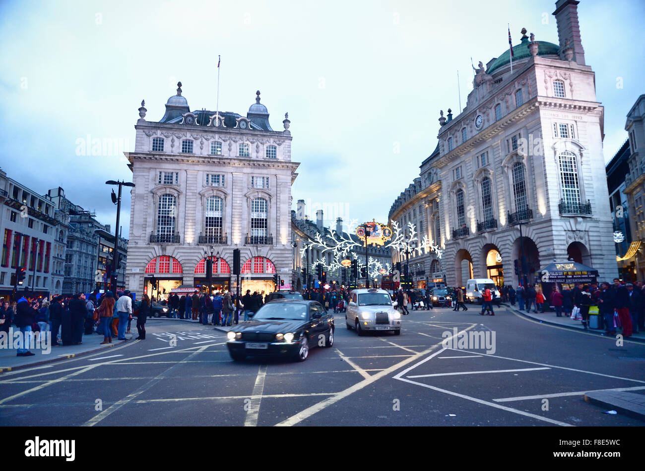 People and traffic in Picadilly Circus, Famous public space in London's West End. London, England, United Kingdom - Stock Image