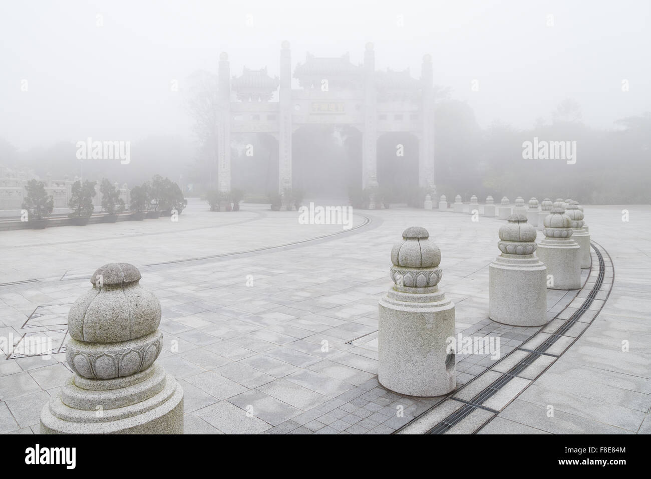Mountain Gate at the Po Lin Monastery on Lantau Island in Hong Kong, China, at a foggy morning. - Stock Image
