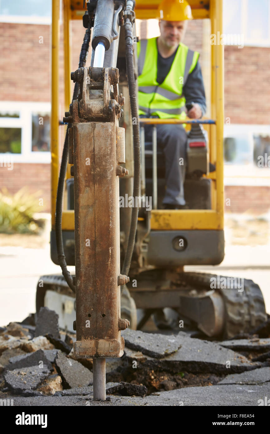 Construction Worker Operating Digger On Site - Stock Image