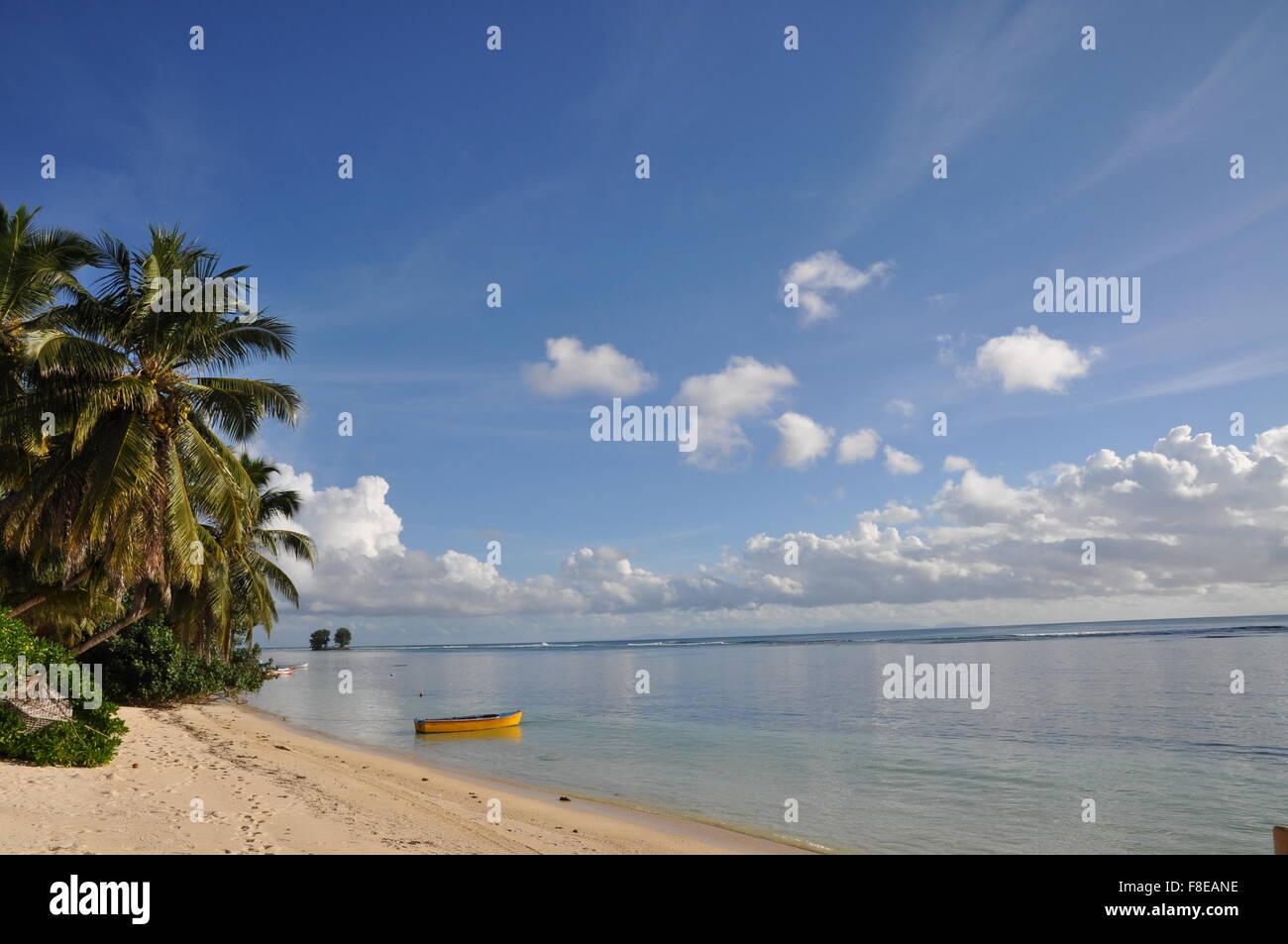 A small dinghy on a tropical beach, La Digue Island, Seychelles Stock Photo