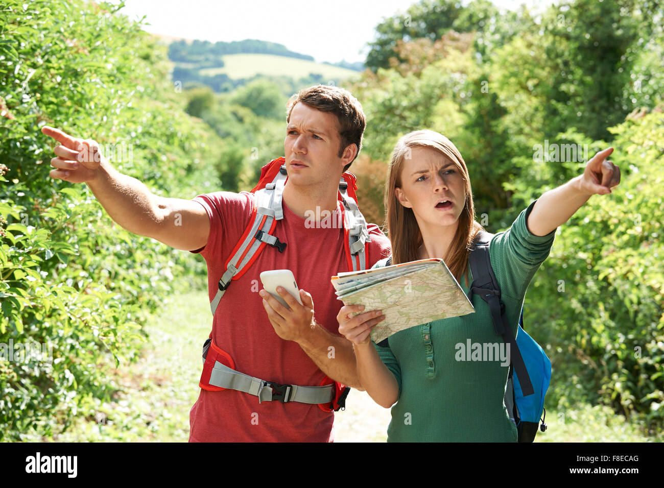 Couple Disagreeing About Best Way To Navigate On Hike - Stock Image