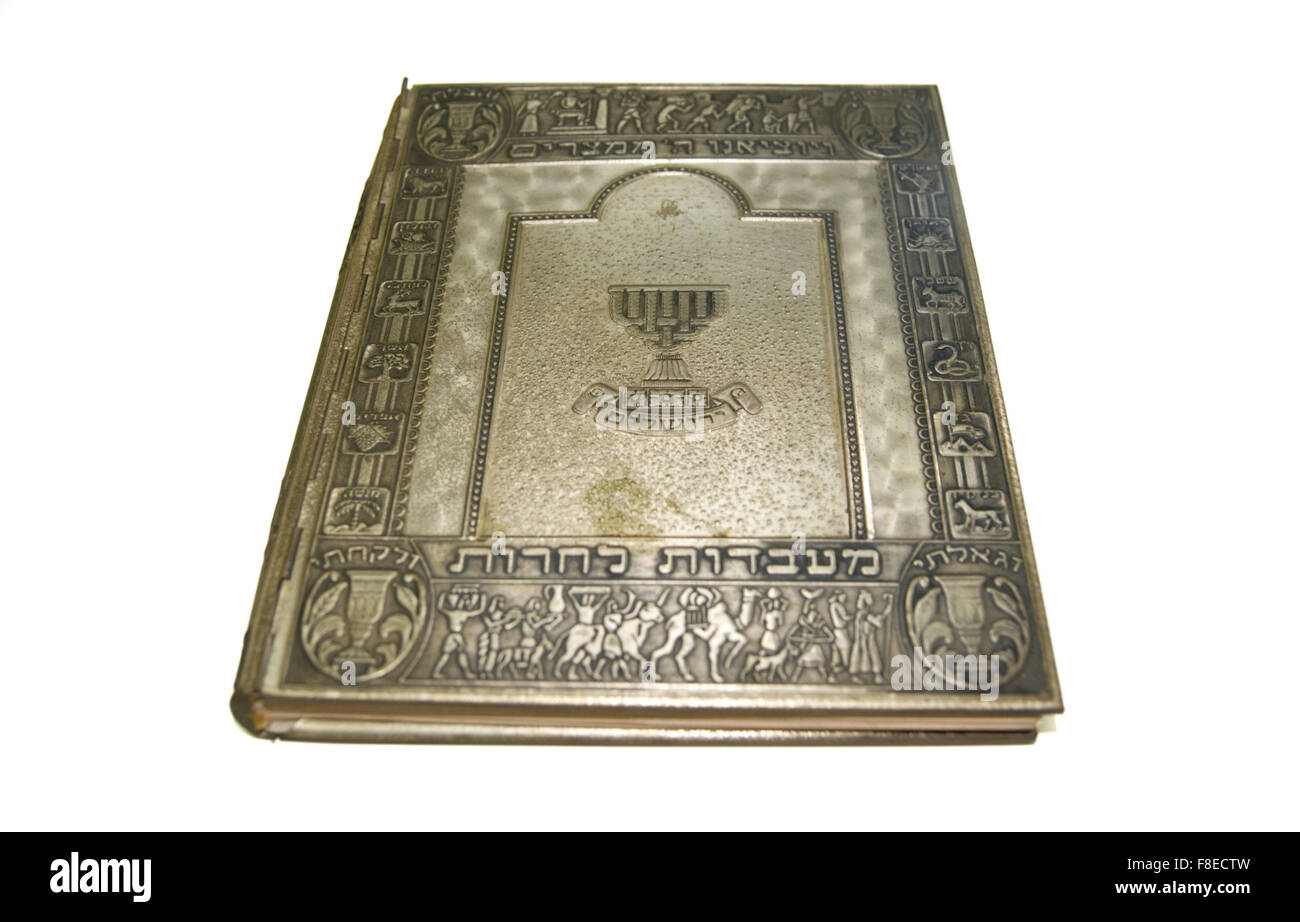 Decorated silver Passover Haggadah On white Background - Stock Image