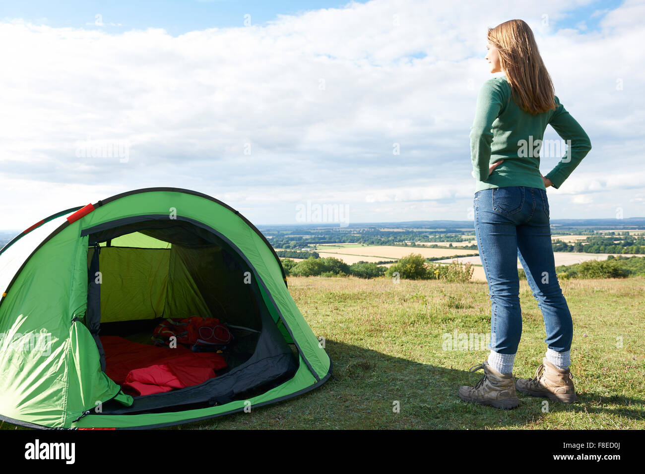 Woman Admiring View On Camping Holiday - Stock Image