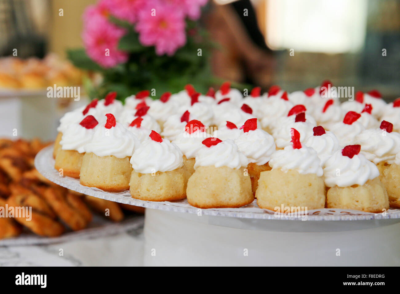 rum baba (or baba au rhum) a small yeast cake saturated in rum, and filled with whipped cream or pastry cream - Stock Image