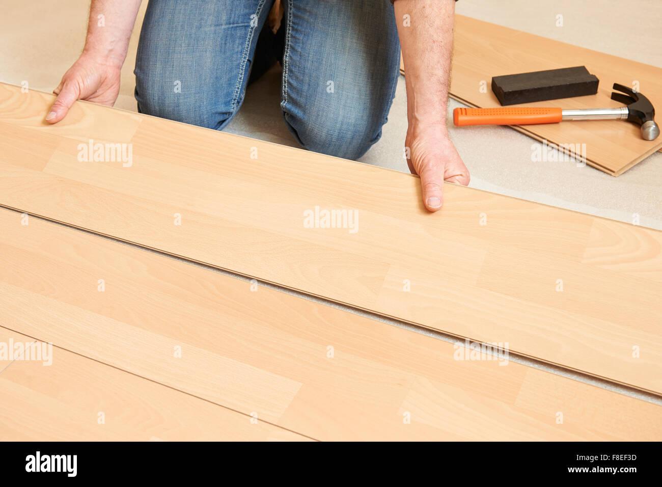Man Laying Laminate Flooring Stock Photo