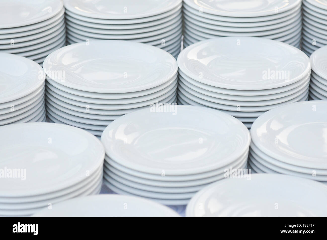 Clear White dishes are ready to use. Waiters use to prepare it before lunch or dinner in few words, the 'mise - Stock Image