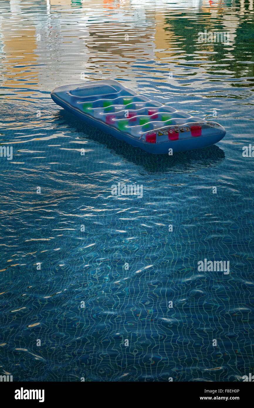 air bed floating  in swimming pool - Stock Image