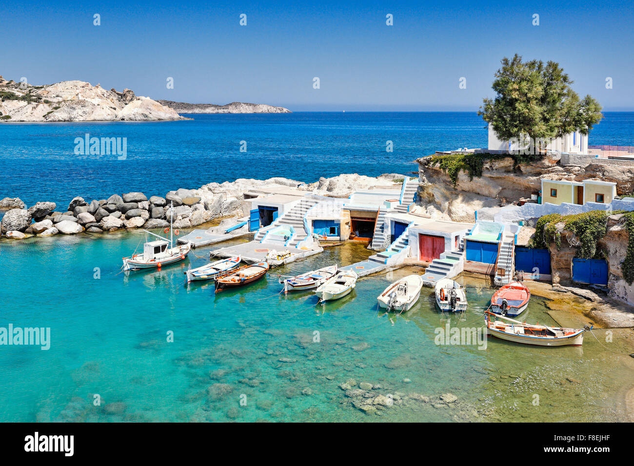 "Traditional fishermen houses with the impressive boat shelters, also known as ""syrmata"" in Mandrakia of Milos, Greece - Stock Image"