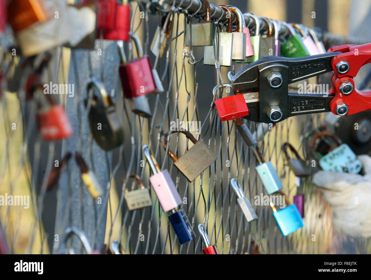 Love locks are removed from the security fence on the 'Slinky springs to fame' bridge in Oberhausen, Germany, - Stock Image