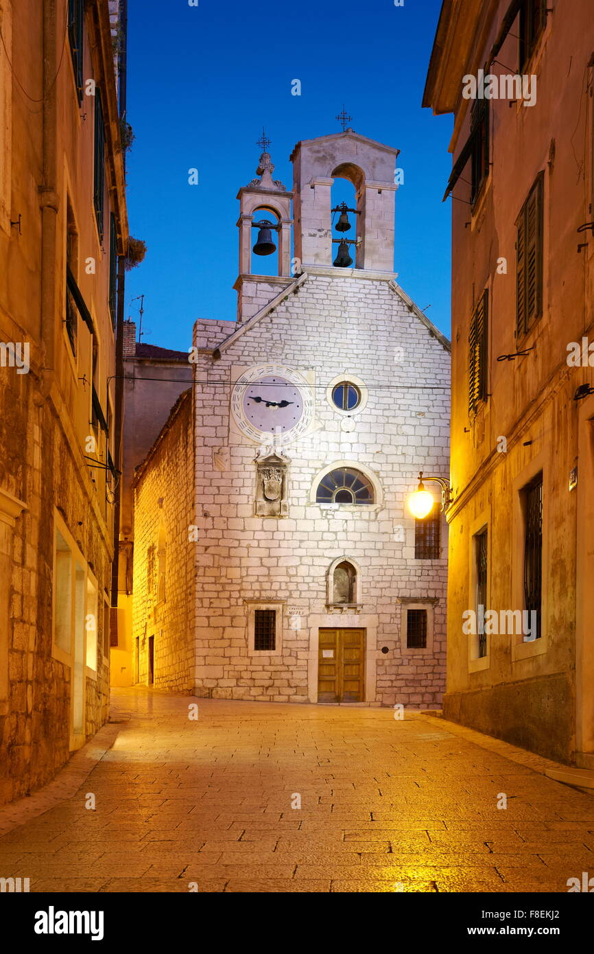 Sibenik, Croatia - Old town street with the Church of Saint Barbara - Stock Image