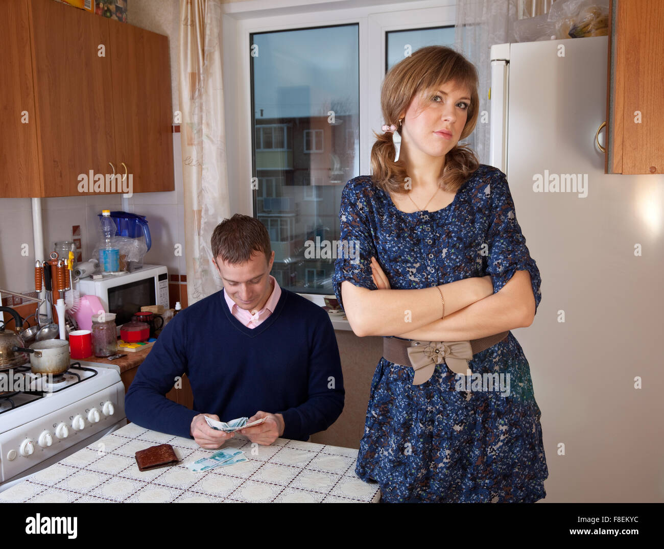 Quarrel in the family due to lack of money Stock Photo