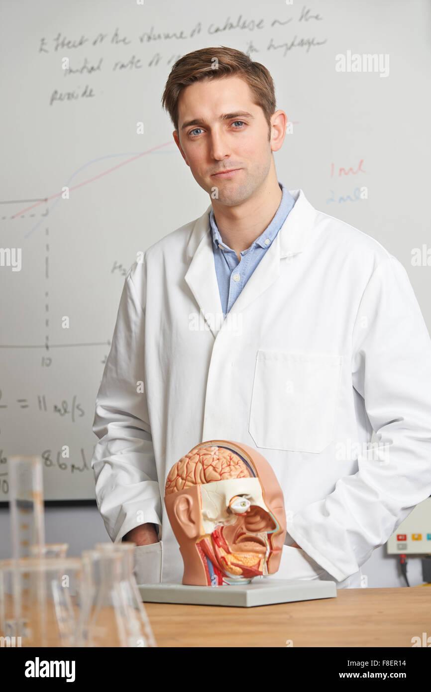 Portrait Of Biology Teacher In Class - Stock Image