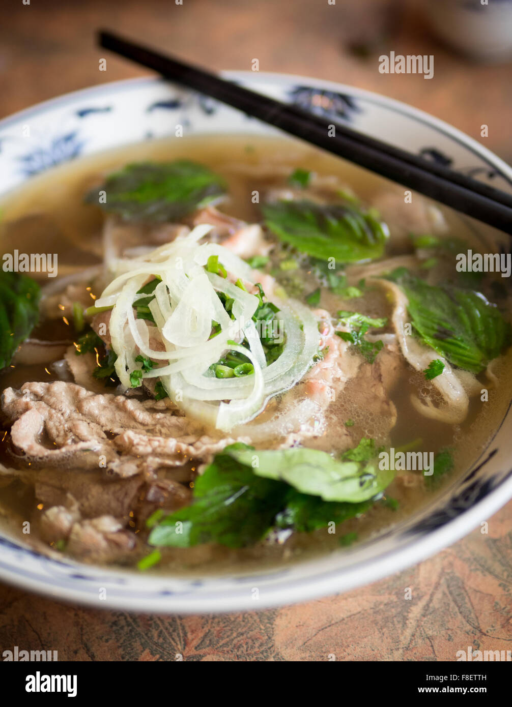 A bowl of beef brisket pho, a popular Vietnamese noodle soup. Stock Photo