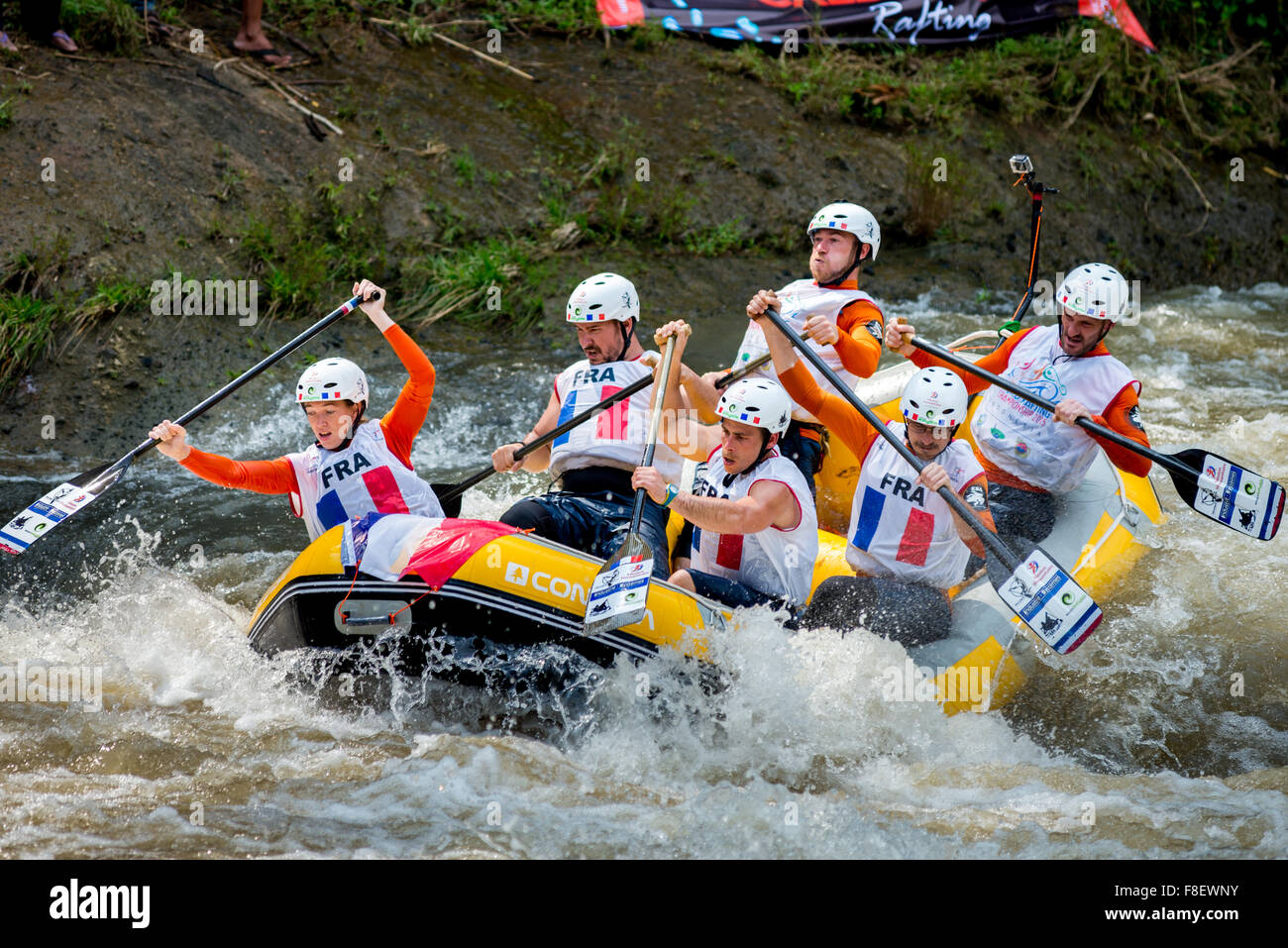 The French open men's team with one female rafter on boat in action during sprint race category on 2015 World - Stock Image