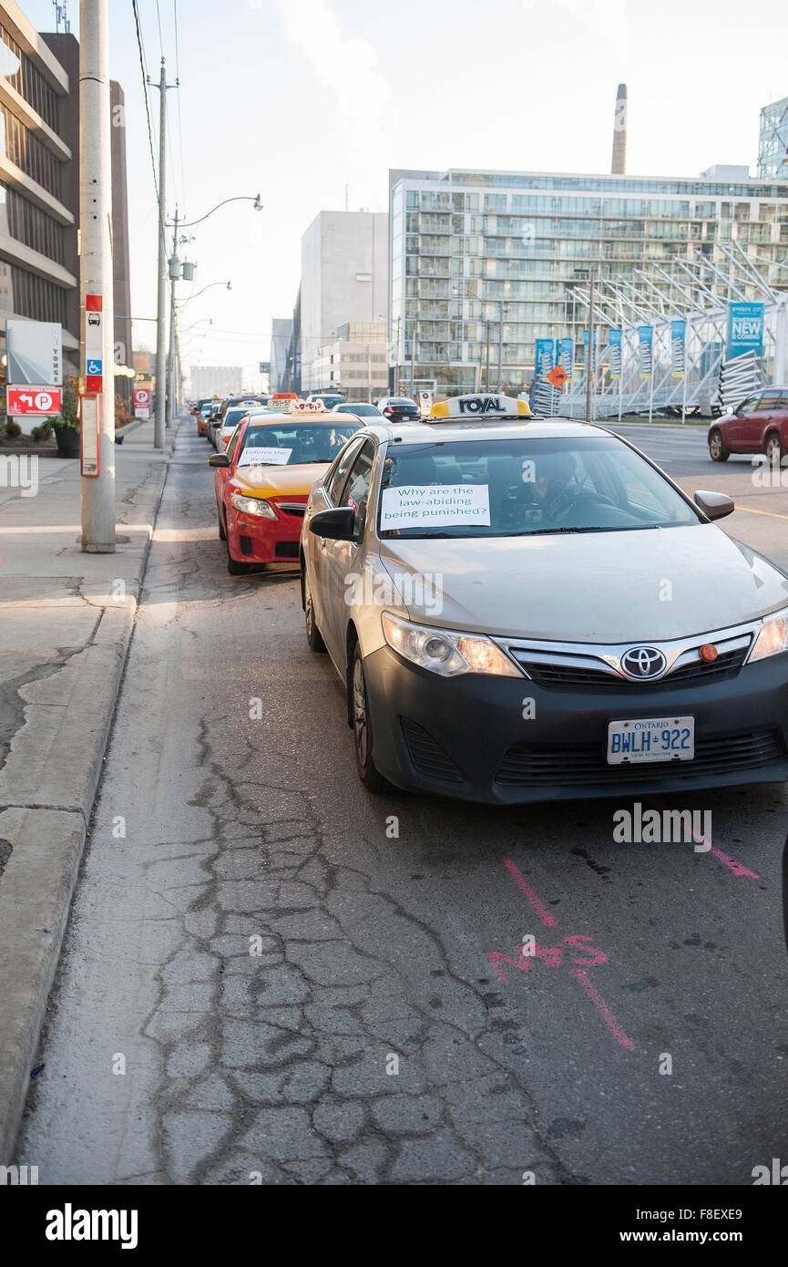 Toronto, Canada. 9th December 2015. Toronto taxi drivers gather to stage a demonstration against Uber taxi service Stock Photo