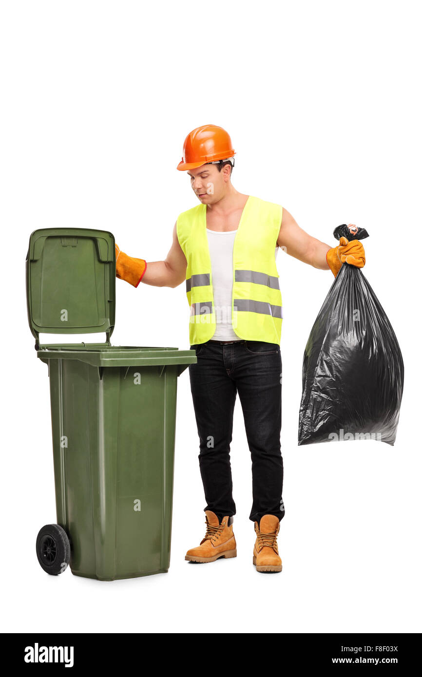 Full length portrait of a male waste collector picking up a bag from a trash can isolated on white background - Stock Image