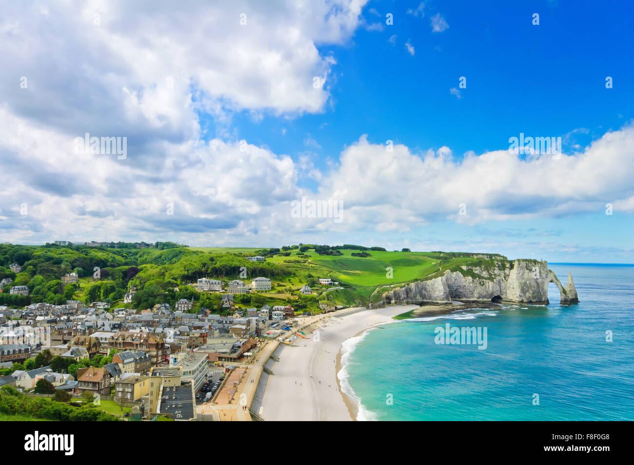 Etretat village, its bay beach and Aval cliff landmark. Aerial view. Normandy, France, Europe. - Stock Image