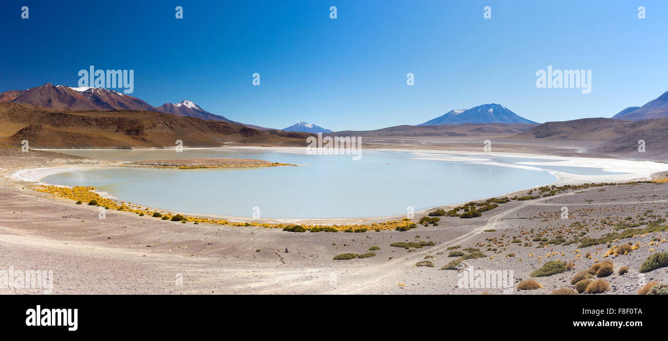 Panoramic view of 'Laguna Canapa', a frozen salty lake on the way to the famous Uyuni Salt Flat, among the - Stock Image