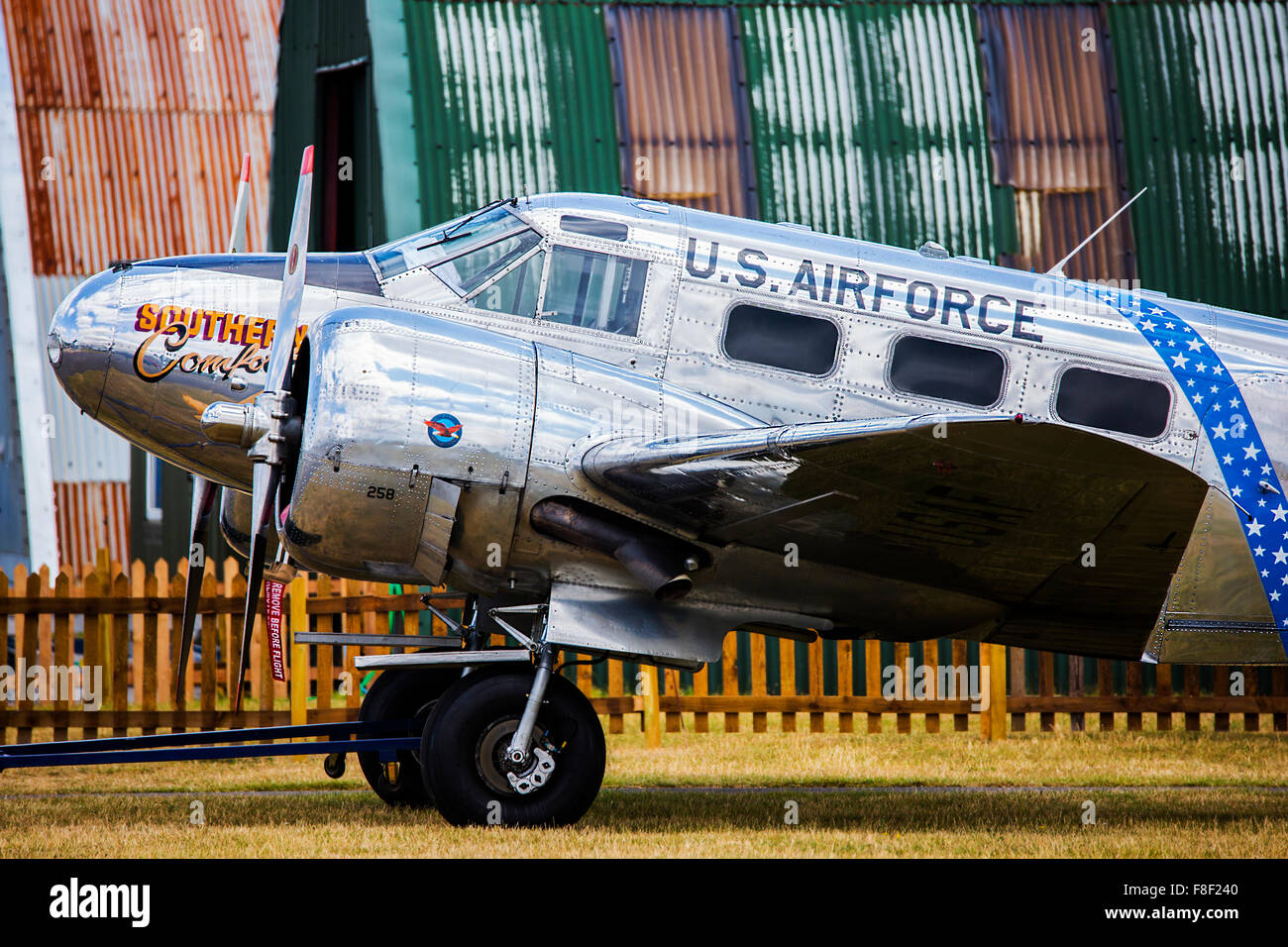 Beechcraft C-45H Expeditor parked during Duxford Air Show next to a hangar at Duxford Airfield - Stock Image