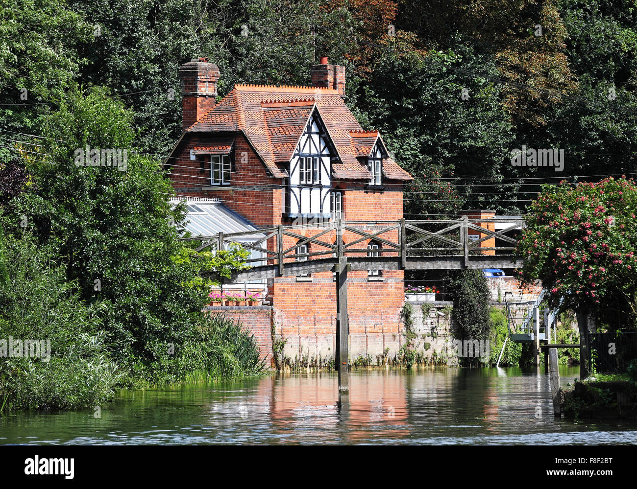 House on the Banks of the River Thames by Henley lock in England Stock Photo