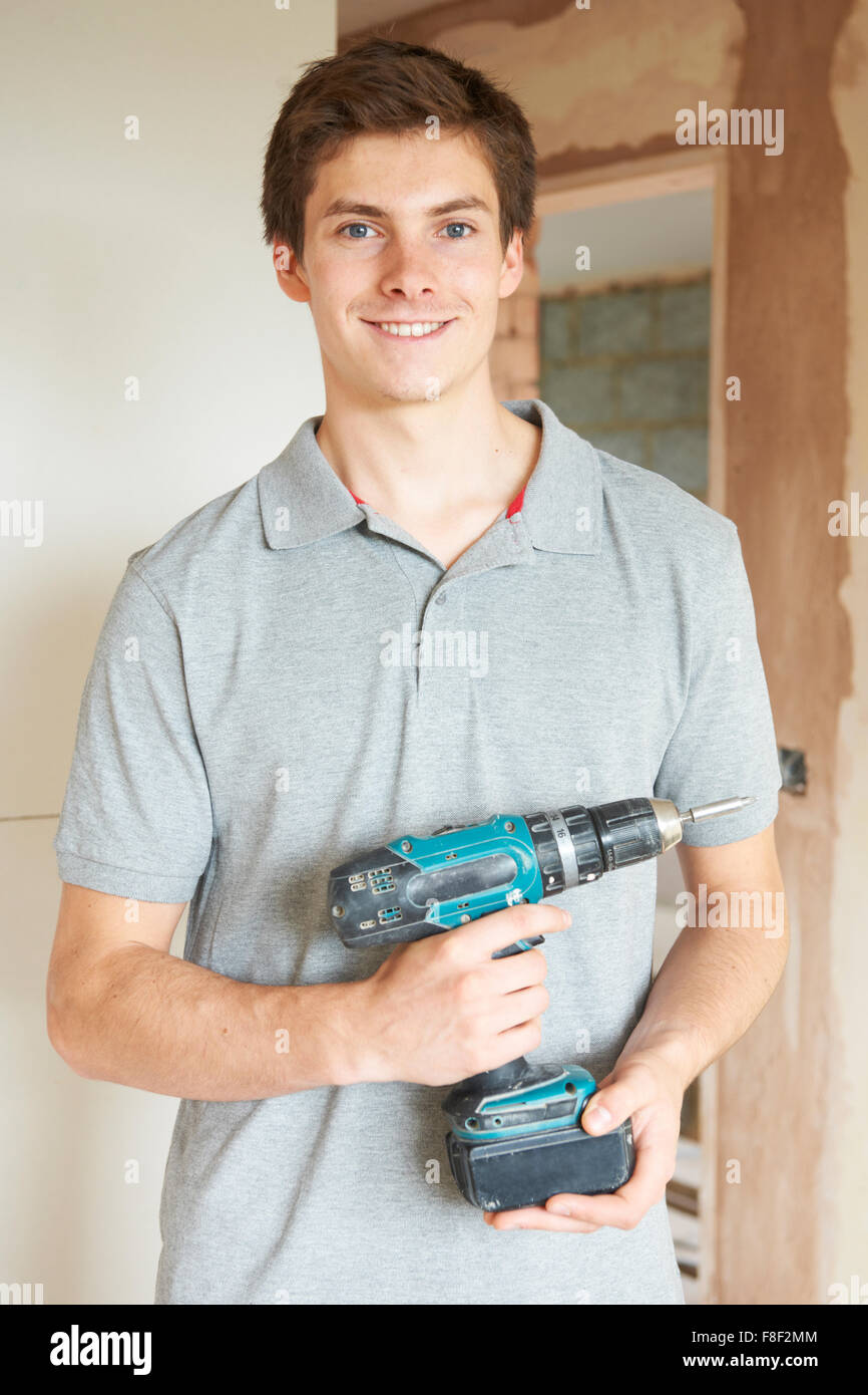 Builder Using Power Tool On Site - Stock Image