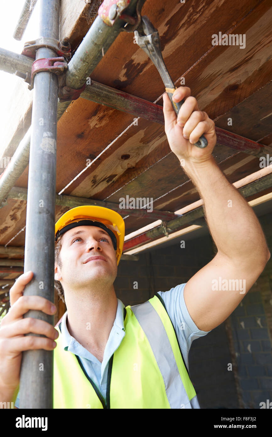 Builder Putting Up Scaffolding - Stock Image