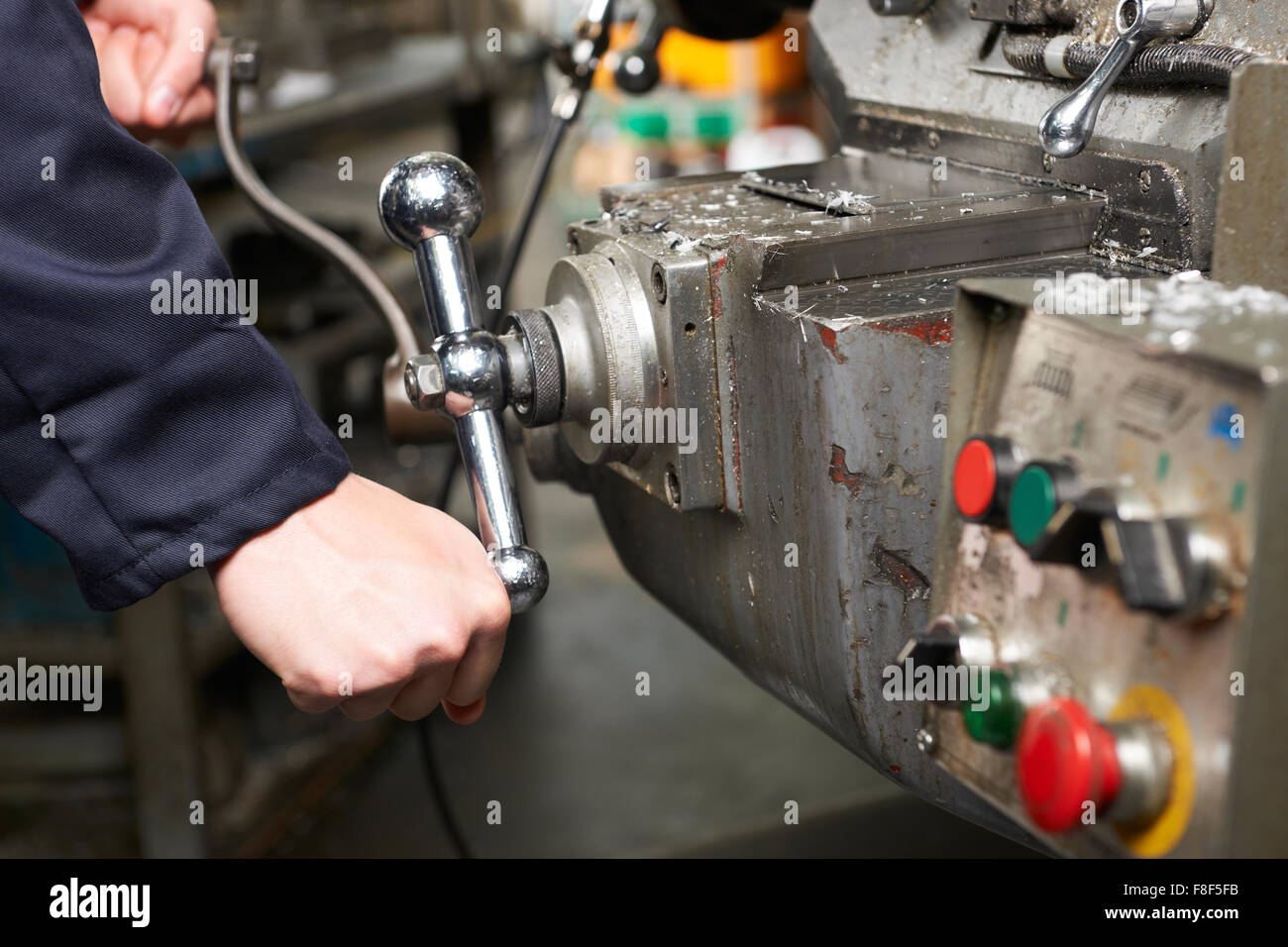 Detail Of Engineers Hands Operation Controls On Lathe - Stock Image