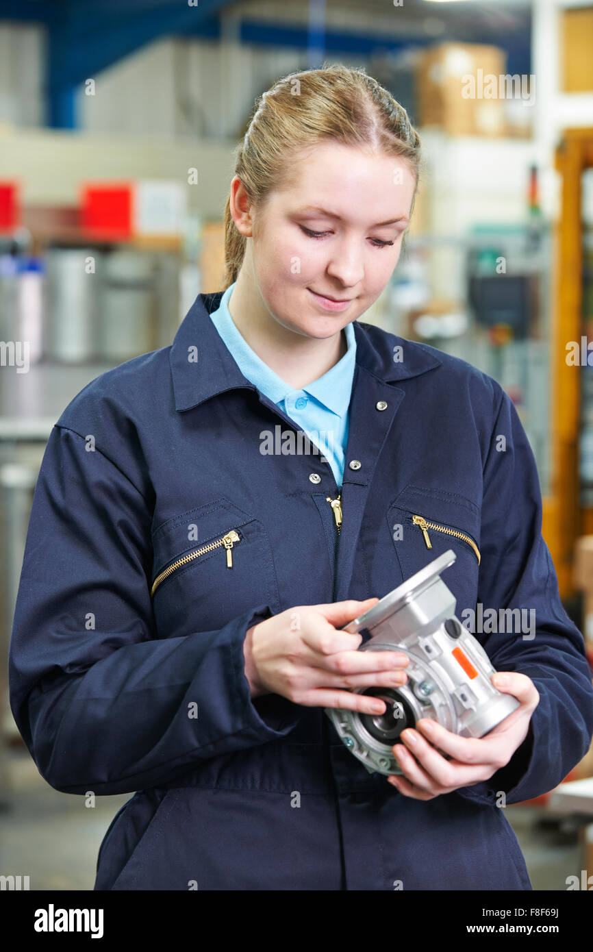 Female Apprentice Engineer industry Component - Stock Image