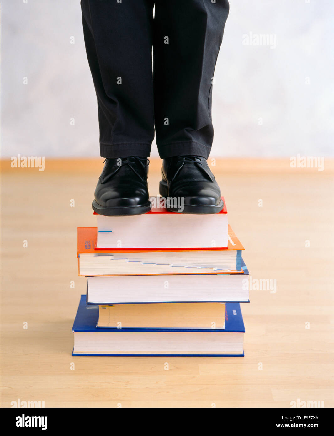 man on a bookpile - Stock Image